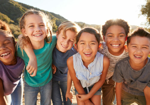 Portrait,Of,Multi-cultural,Children,Hanging,Out,With,Friends,In,Countryside