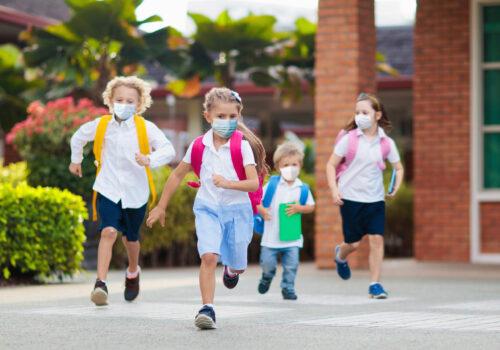 School,Child,Wearing,Face,Mask,During,Corona,Virus,And,Flu